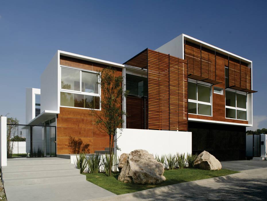 Echauri Morales Arquitectos Minimalist houses Wood effect