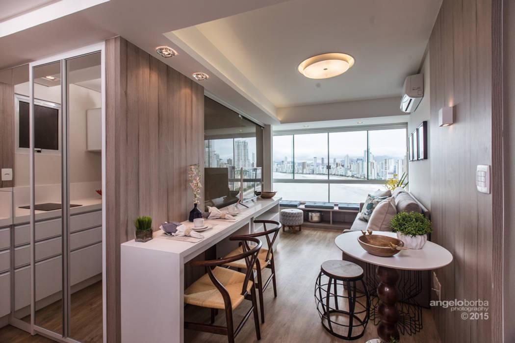 Salas de estilo  por Claudia Stach e Daniela Bordignon Arquitetura, Moderno Tablero DM