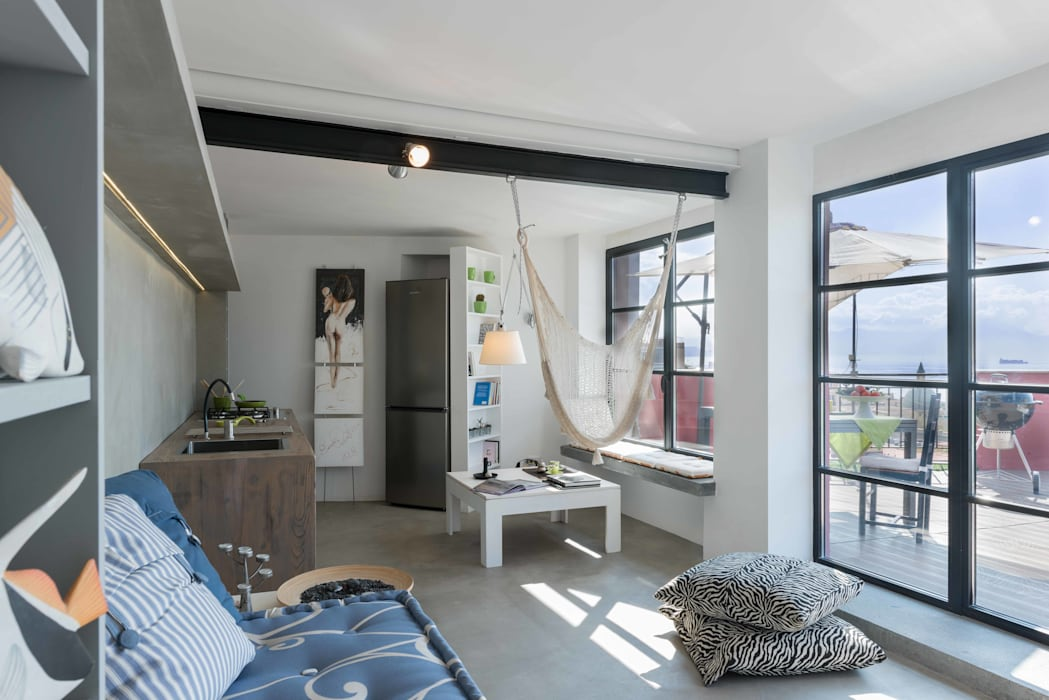 Industrial style houses by architetto Lorella Casola Industrial