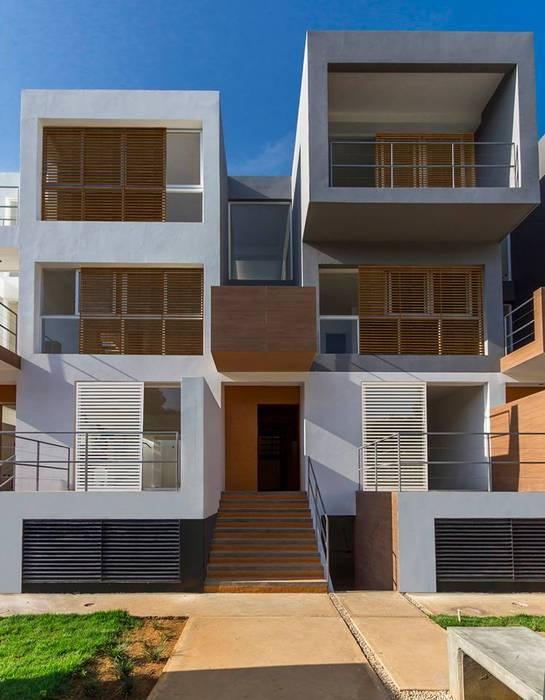 RESIDENCIAS PARQUE VIRGINIA: casas entre luces: Casas de estilo  por NMD NOMADAS, Clásico
