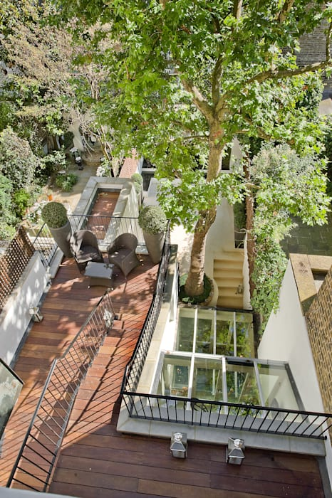 Outdoor balcony and terrace at Chester Street House by Nash Baker Architects Ltd Classic