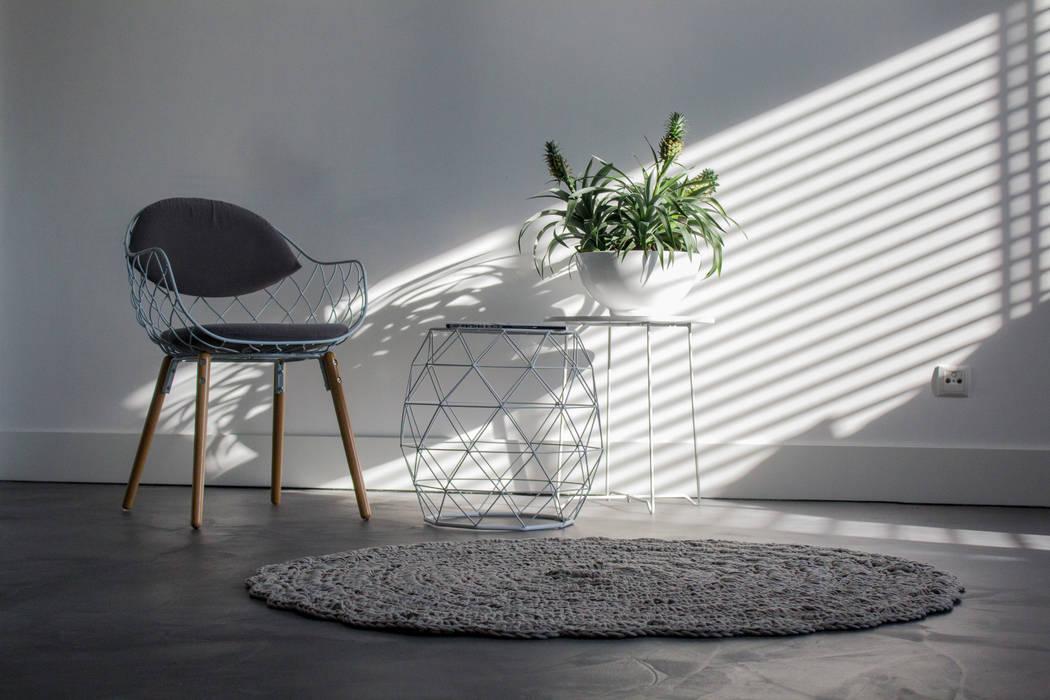 Living room by Motion Gietvloeren, Modern