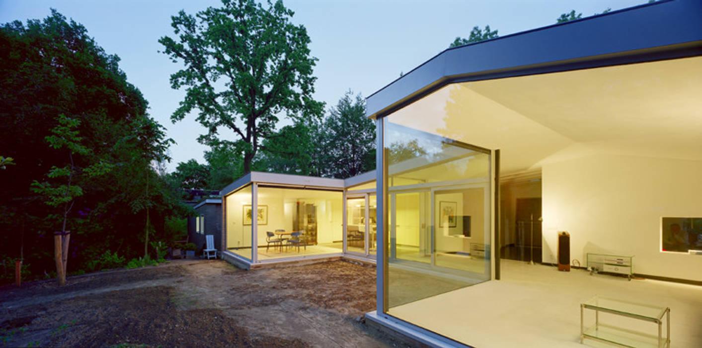 uitbreiding woonhuis Moderne woonkamers van JMW architecten Modern Glas