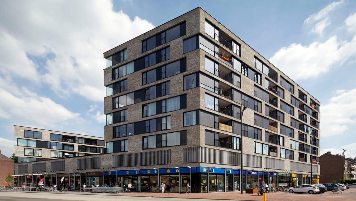 appartementen en commerciële voorzieningen:  Huizen door JMW architecten