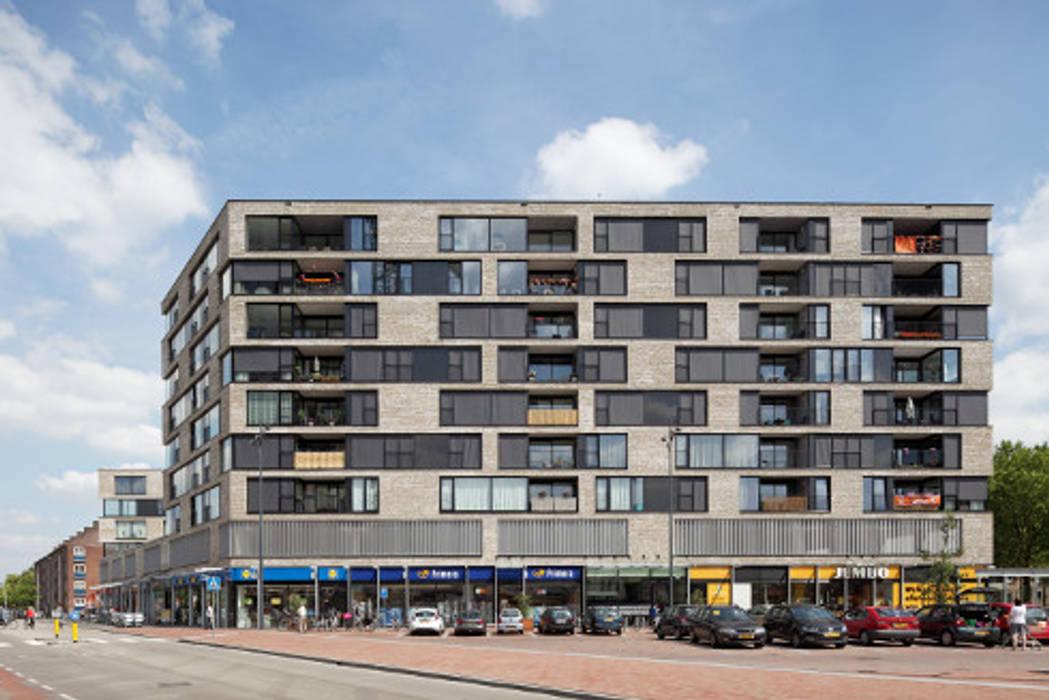 appartementen en commerciële voorzieningen Moderne huizen van JMW architecten Modern Stenen
