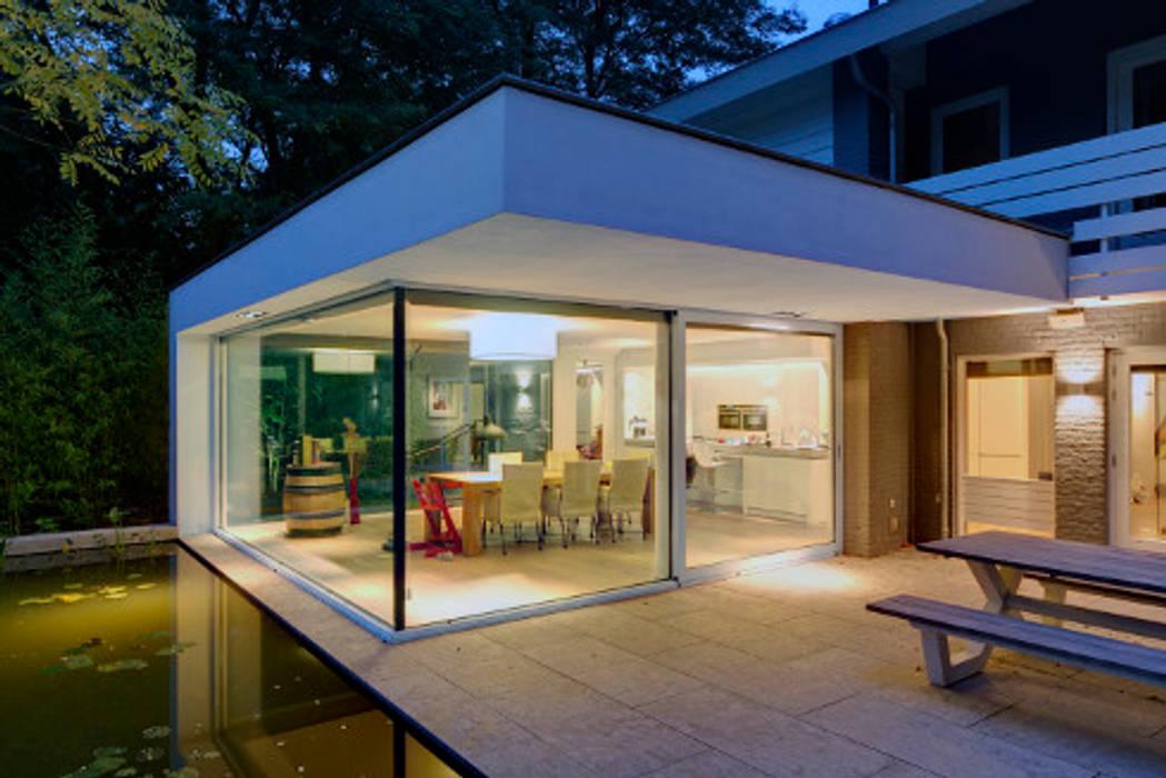 uitbreiding woonhuis:  Terras door JMW architecten