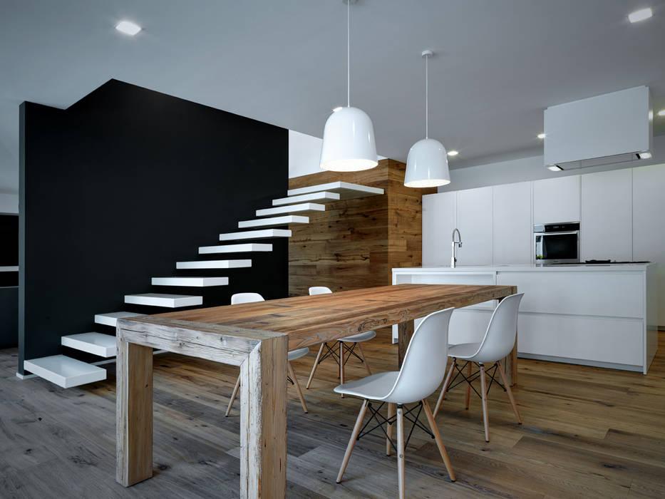 Progetto Sala da pranzo moderna di EV+A Lab Atelier d'Architettura & Interior Design Moderno