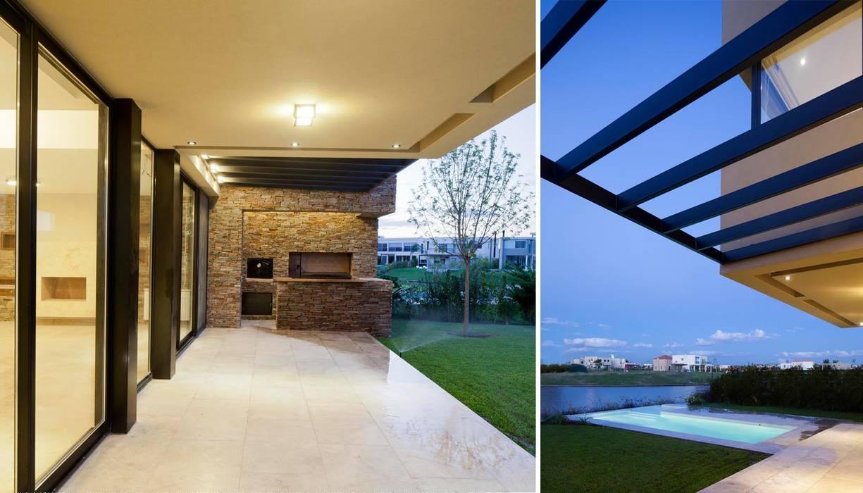 CASA JN: Jardines de estilo  por Speziale Linares arquitectos