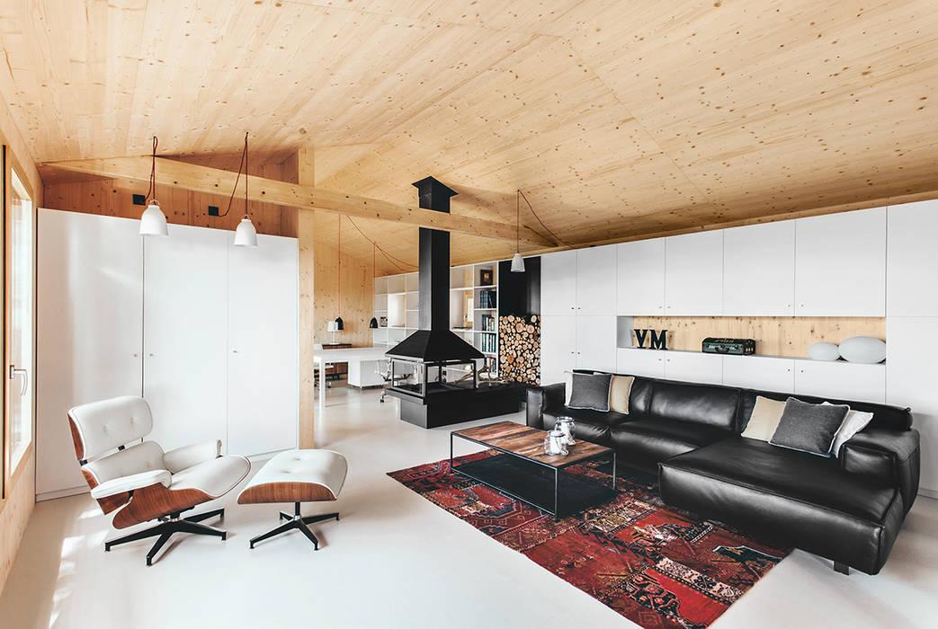 Salas de estar modernas por dom arquitectura Moderno