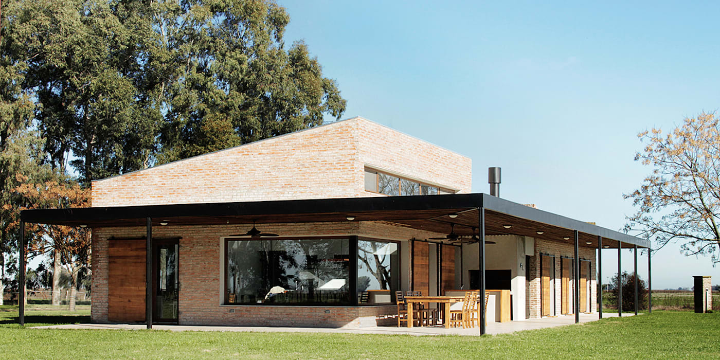 Houses by BAM! arquitectura, Country