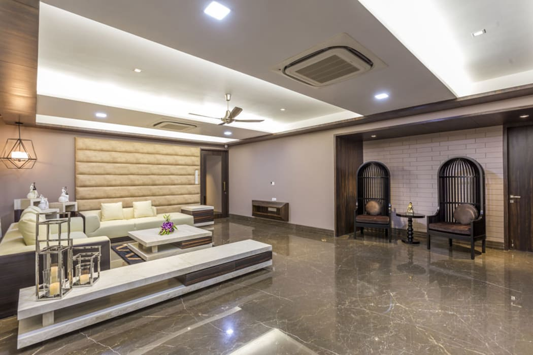 Kabra House:  Living room by Spaces and Design