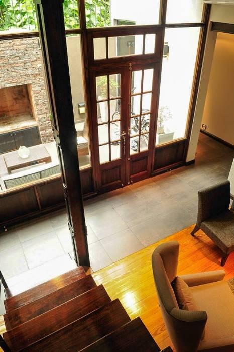 Sala de estar Salones de estilo minimalista de Radrizzani Rioja Arquitectos Minimalista Madera Acabado en madera