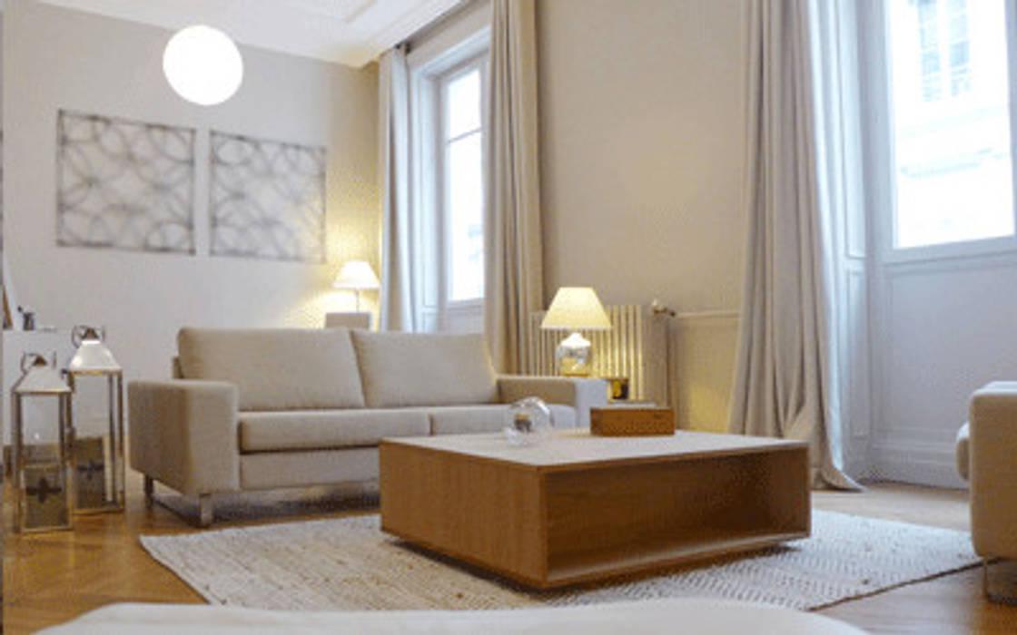 Un salon cosy-chic: Salon de style de style Moderne par Skéa Designer