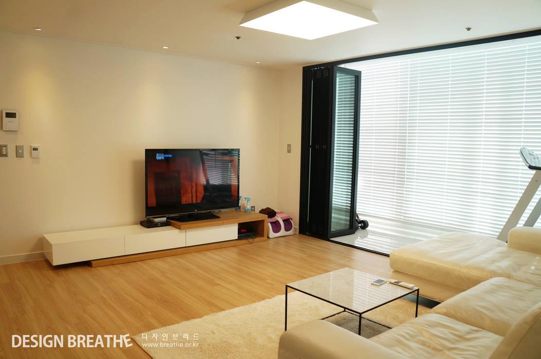 Salones de estilo  de 디자인브리드, Moderno