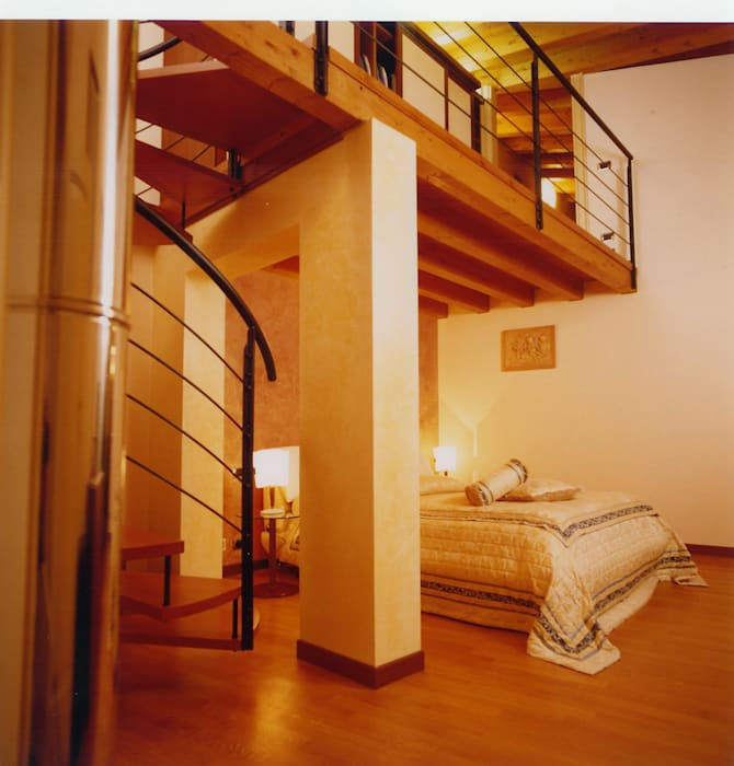 camera matrimoniale ospiti : Camera da letto in stile in stile Moderno di STUDIO ARCHITETTURA SPINONI ROBERTO