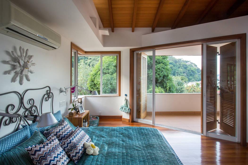 Casa Horto OBM 79: Quartos  por Maria Claudia Faro,Tropical