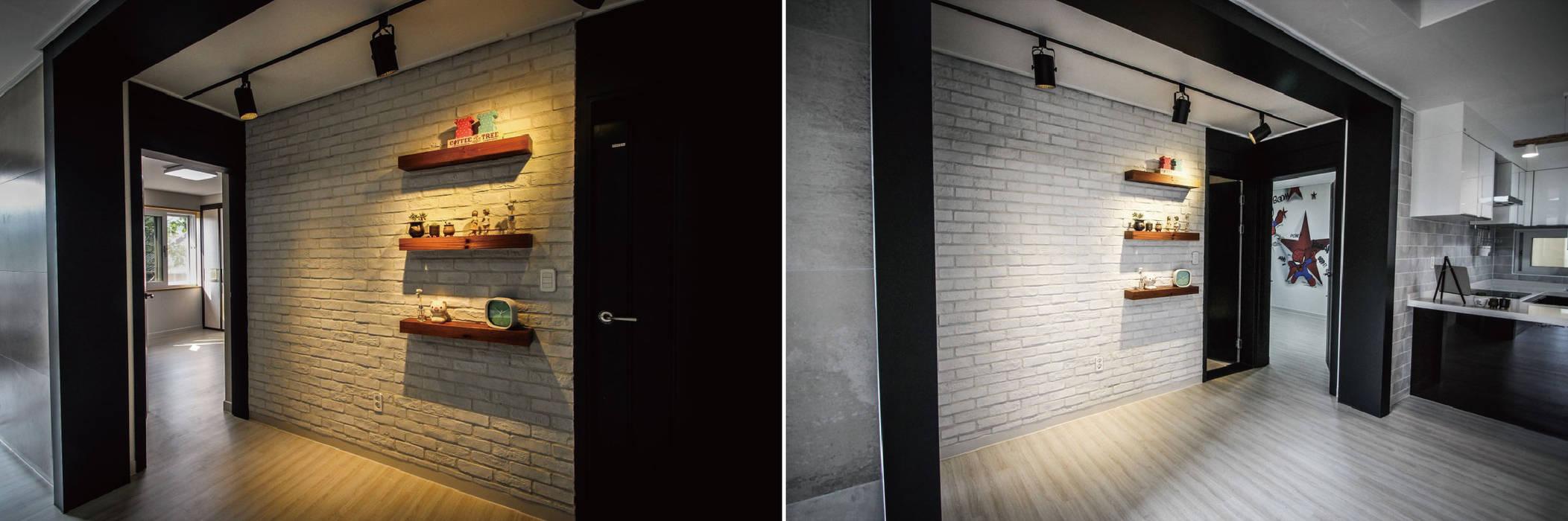 Paredes y pisos de estilo moderno de homify Moderno