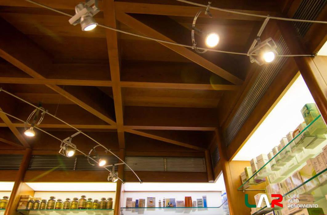 Illuminazione e design: negozi & locali commerciali in stile di lar