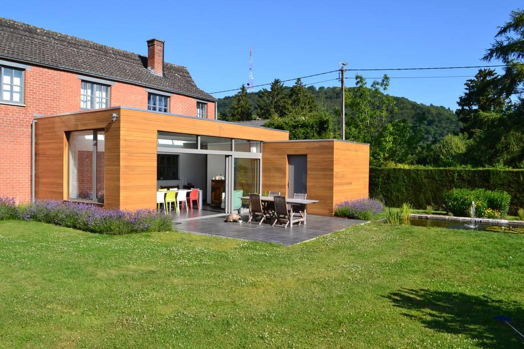 Wilmotte-Mosty: Jardin d'hiver de style  par Wilmotte Architecte