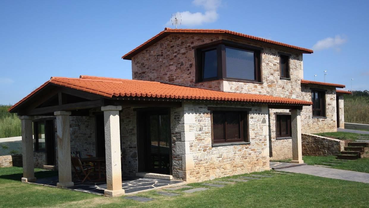 Exterior: Casas de estilo  de Construcciones F. Rivaz