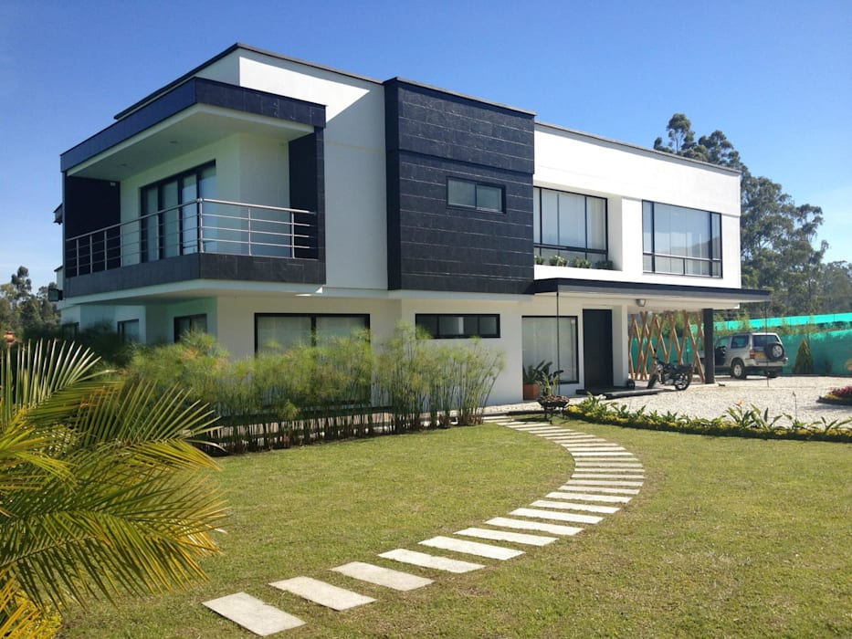 CASA L. Andrés Hincapíe Arquitectos: Casas de estilo  por Andrés Hincapíe Arquitectos  A H A