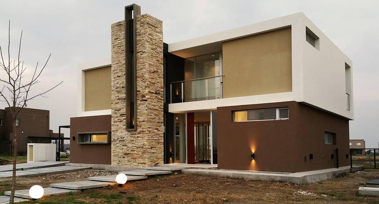 Vivienda Unifamiliar en Barrio el Canton: Casas de estilo  por Estudio Maraude Arquitectos