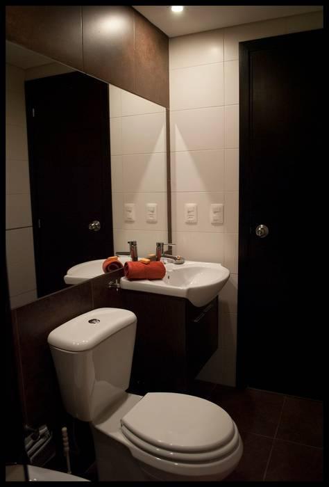 Baños pequeños soluciones grandes: Baños de estilo  por Diseñadora Lucia Casanova