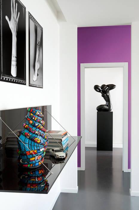 PDV studio di progettazione Corredor, hall e escadasCómodas e estantes Preto