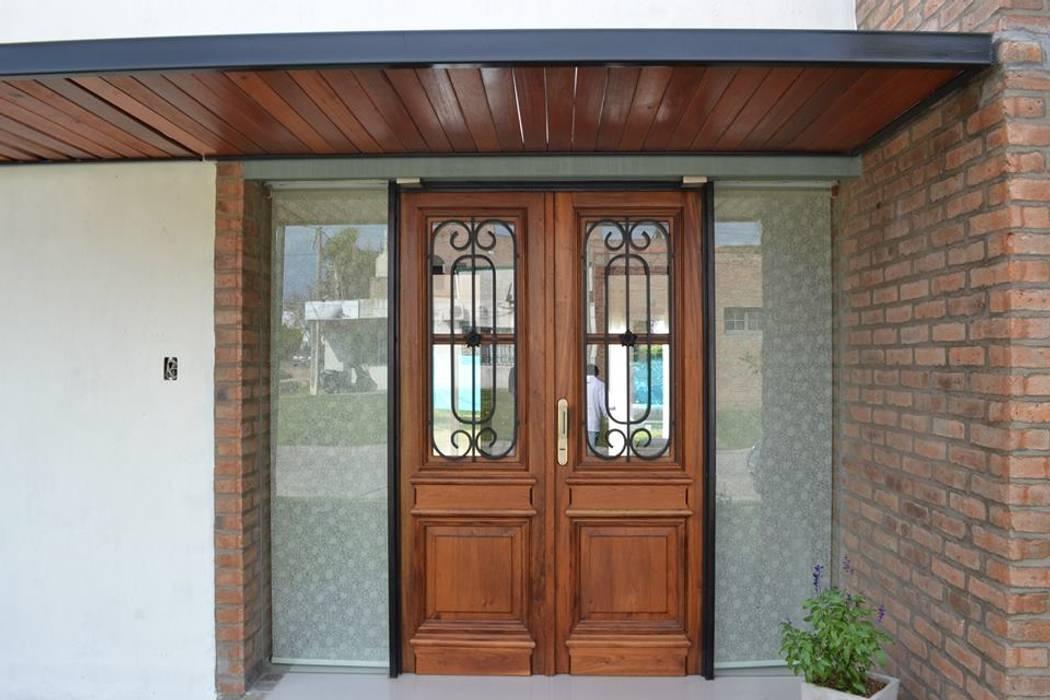 Casa Caro & Emi Fenêtres & Portes modernes par Aureo Arquitectura Moderne