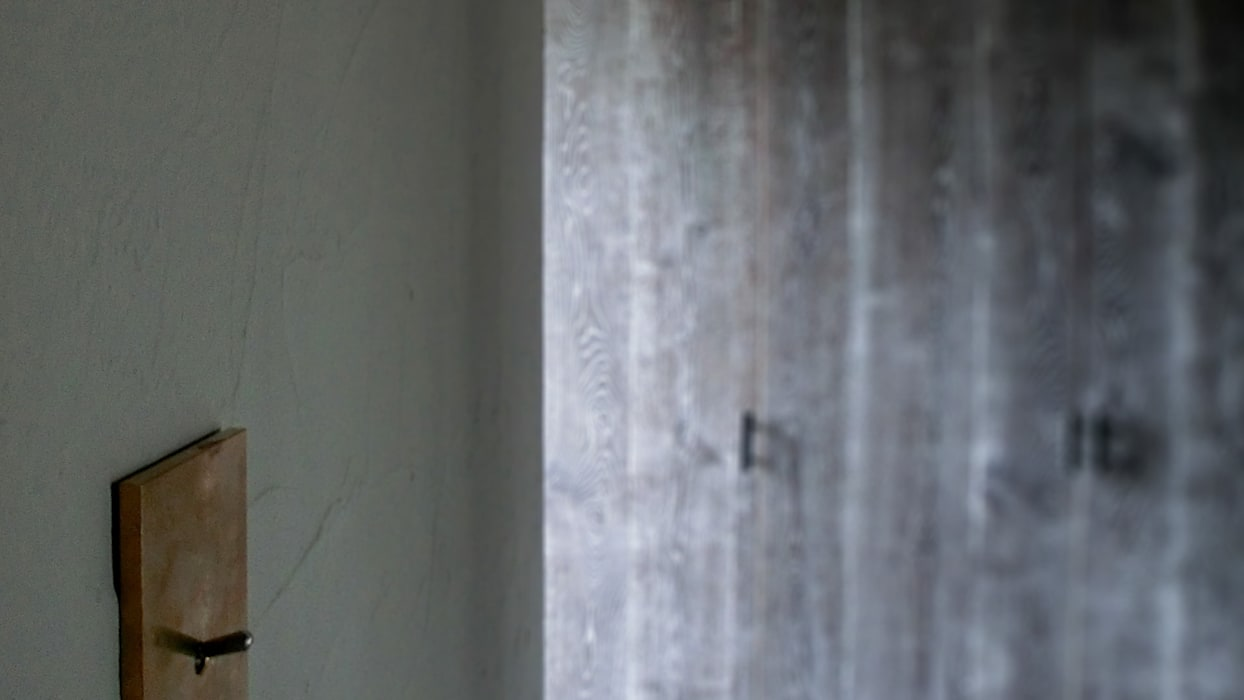 Apartment in Kisibe: Mimasis Design/ミメイシス デザインが手掛けた壁です。