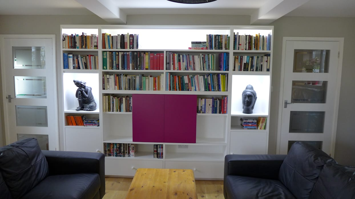 TV hidden in wall unit:  Media room by Style Within