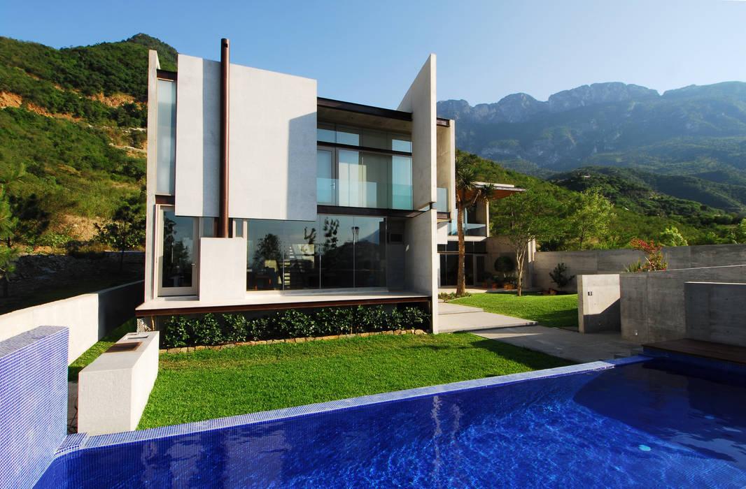 Casas de estilo  por homify , Moderno Hormigón