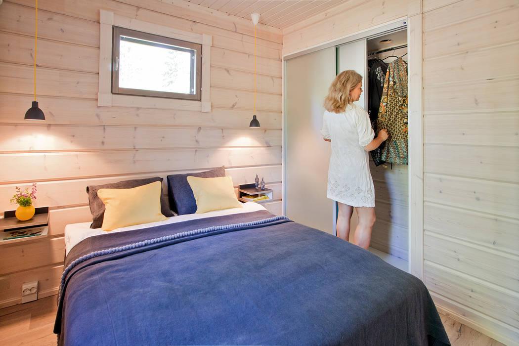 Camera da letto in stile  di homify, Scandinavo