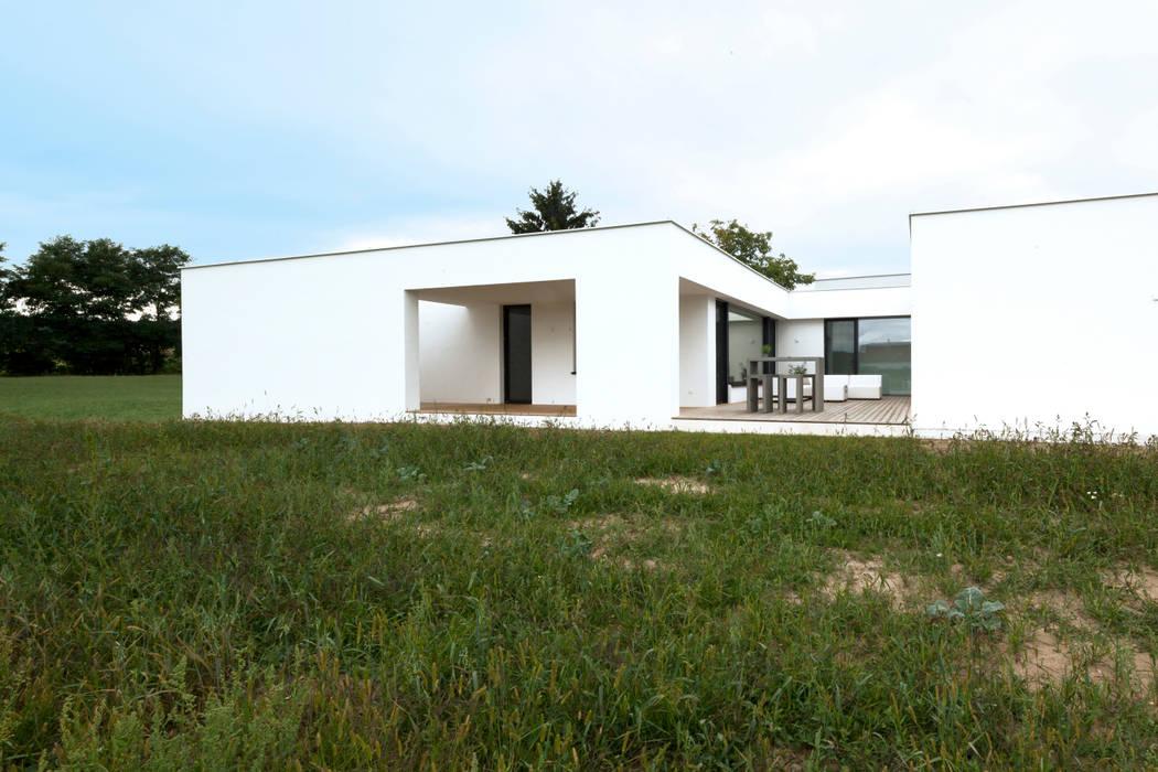 Casas de estilo moderno de PASCHINGER ARCHITEKTEN ZT KG Moderno Madera maciza Multicolor