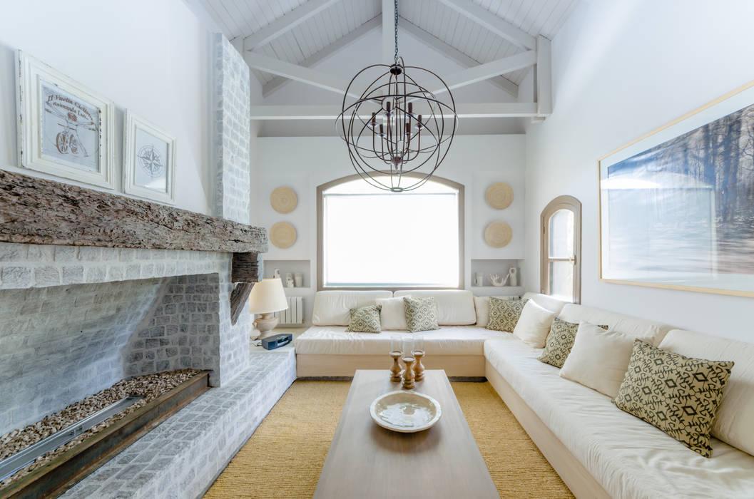 Salas de estar  por BLOS Arquitectos