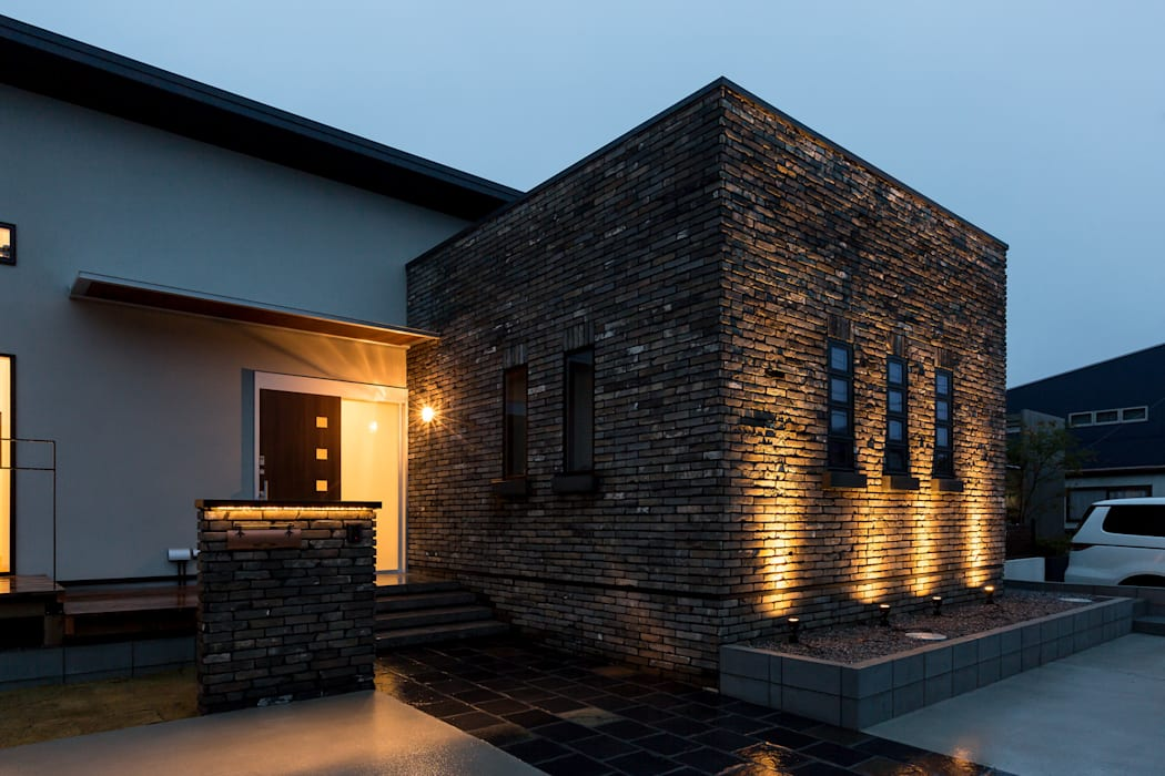 Industrial style houses by 株式会社 鳴尾工務店 Industrial Bricks