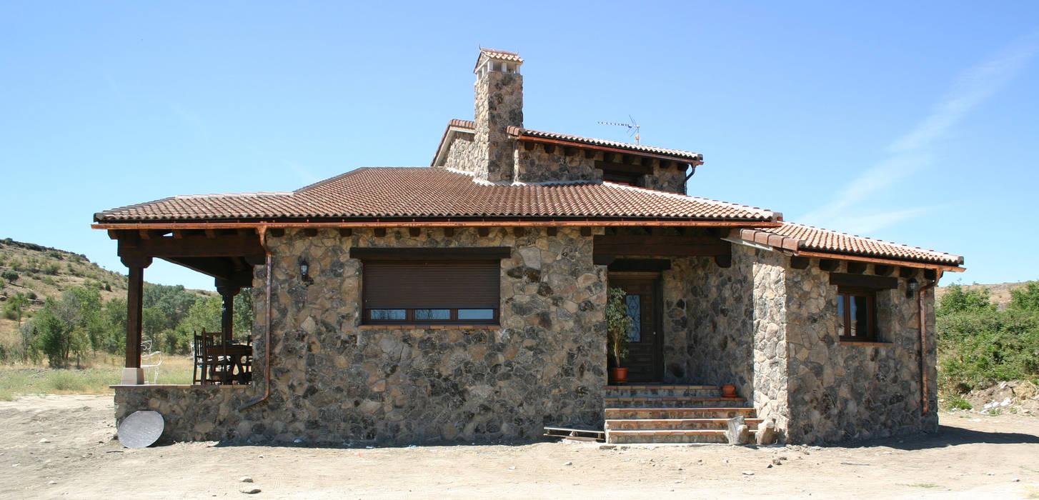 Fachada principal Casas de estilo rústico de Arq0 Rústico