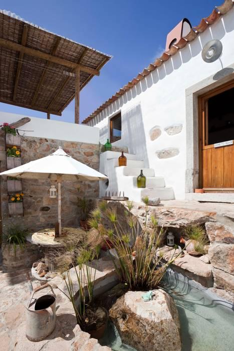 Maisons de style  par pedro quintela studio, Rustique Pierre