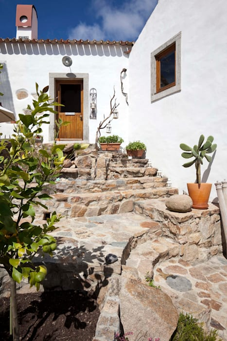 Rustic style house by pedro quintela studio Rustic Stone