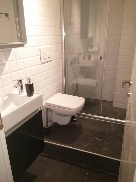 Toilettes after renovation par Pil Tasarım Mimarlik + Peyzaj Mimarligi + Ic Mimarlik