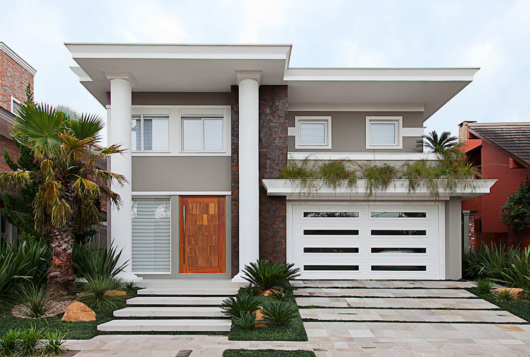 ANDRÉ PACHECO ARQUITETURA Eclectic style houses