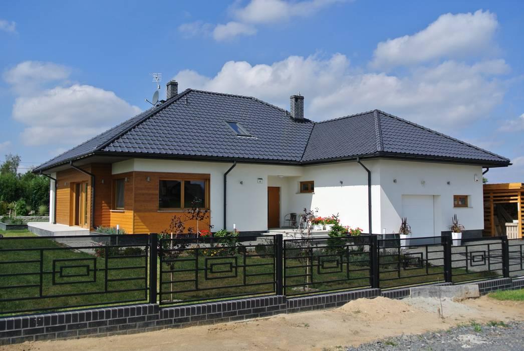 Casas de estilo  por Pracownia Projektowa ARCHIPELAG, Moderno