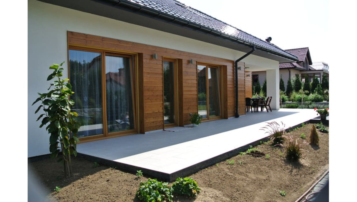Casas de estilo  por Pracownia Projektowa ARCHIPELAG,