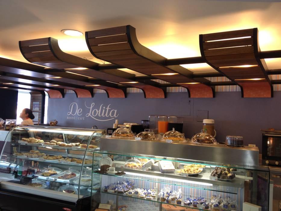 DeLolita Centro Comercial Mayorca: Centros comerciales de estilo  por @tresarquitectos