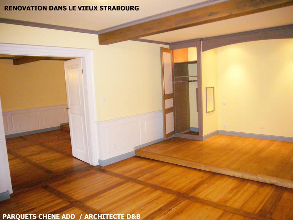 rénovation d'un immeuble ancien à Strasbourg  appartemnts privés: Centres commerciaux de style  par ADD