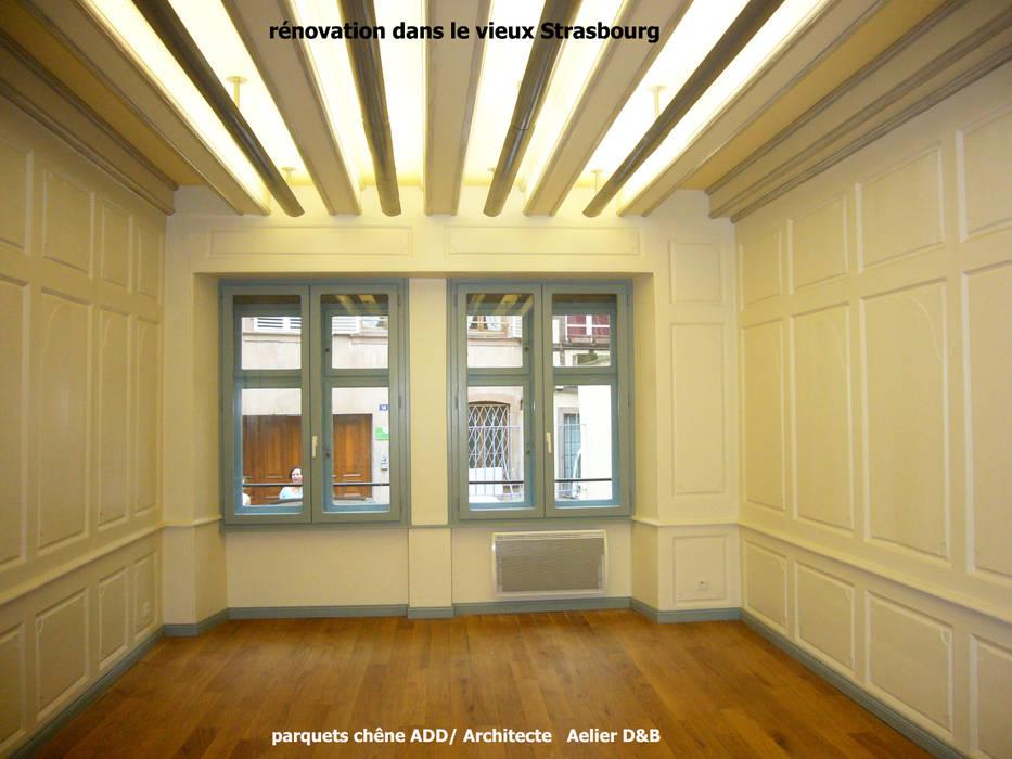 rénovation d'un immeuble ancien à Strasbourg: Espaces commerciaux de style  par ADD
