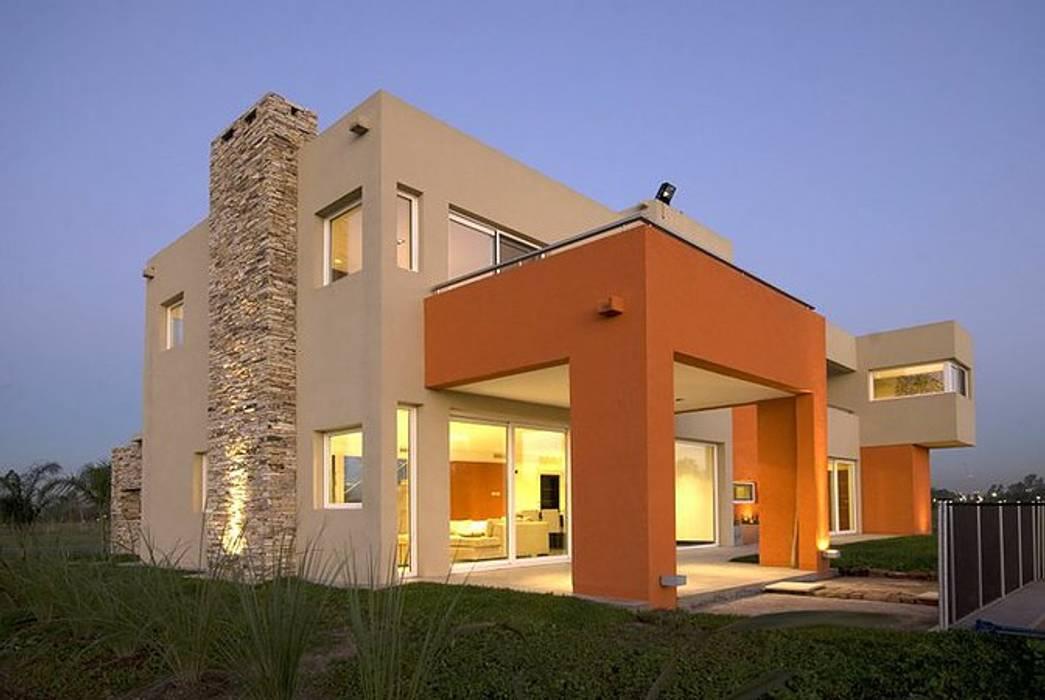 Casa M: Casas de estilo  por Estudio PM,
