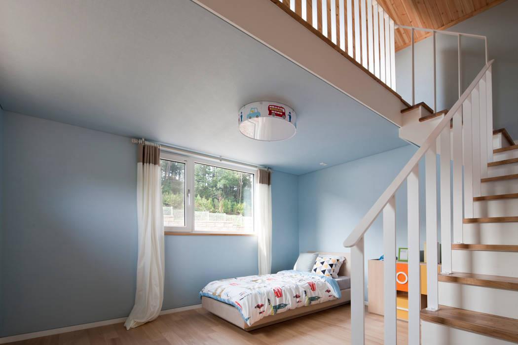 Chambre d'enfant moderne par 리슈건축 Moderne