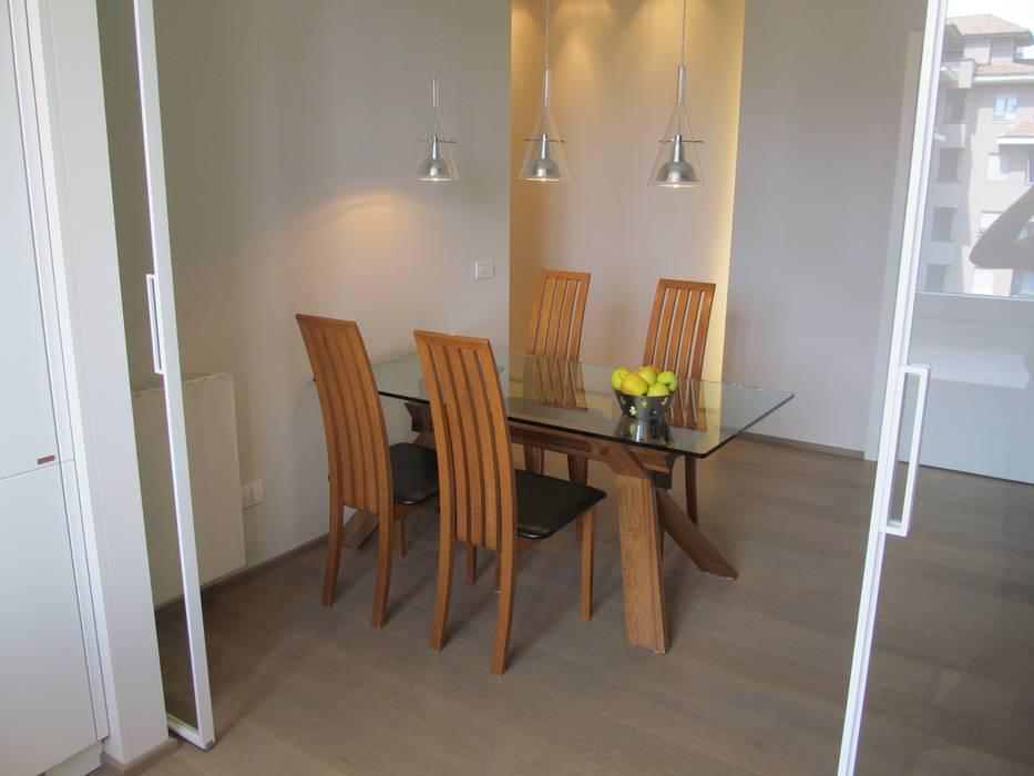 Una stanza in pi sala da pranzo moderna di architetto for Stanza da pranzo moderna