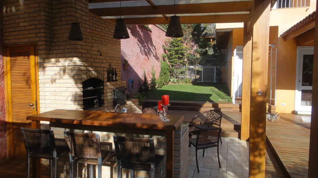 Balkon, Beranda & Teras Gaya Rustic Oleh homify Rustic Batu Bata